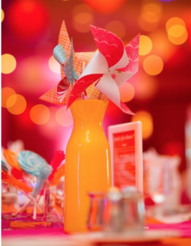 I adore the cheeriness of this whimsical centerpiece. It would be perfect for a tropical venue.