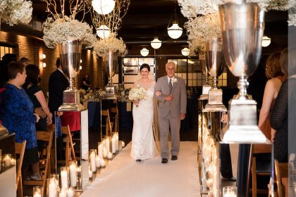Bride and Father Walking Down Aisle in Winter White