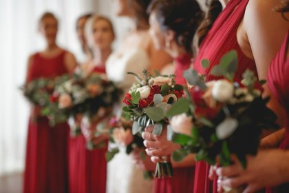 Red, white green bridesmaids bouquets