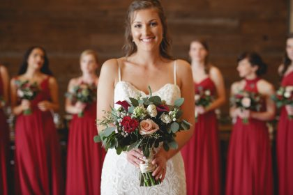 Spring Bridal Portrait with Red Flowers and bridesmaids dresses