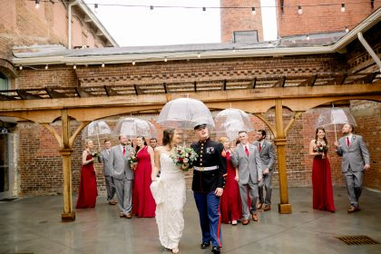 wedding party in the rain photo