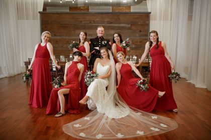 Bride, Groom with bridesmaids in red dresses