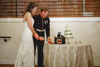 Cutting Groom's Cake at Wedding Reception