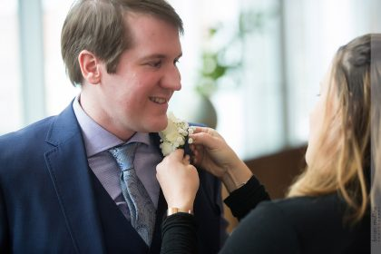 Wedding Coordinator Putting on Boutonniere