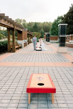 Bride and Groom playing Cornhole at Wedding