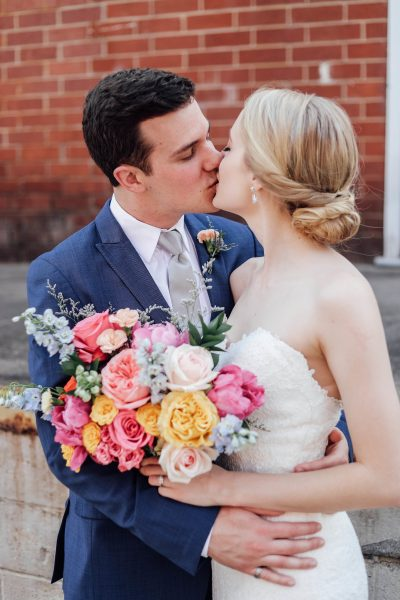 newlywed portrait bright wedding bouquet