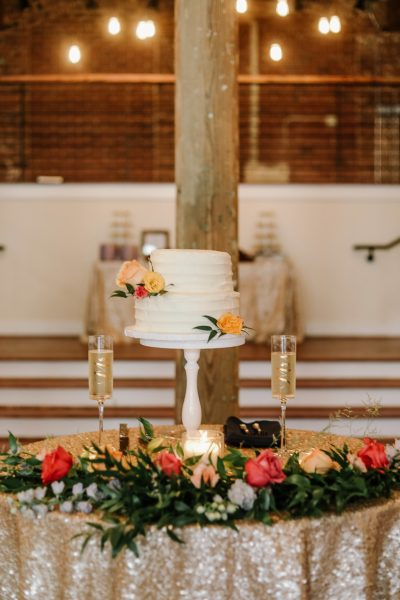 two tier wedding cake with colorful flowers