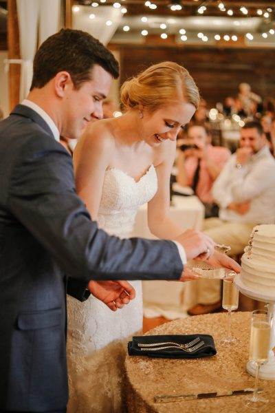 newlyweds cutting the wedding cake