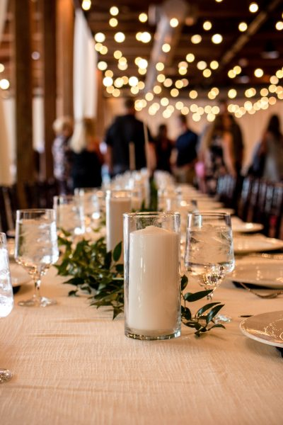 day-of wedding coordination white and green centerpieces