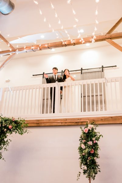 Bride and Groom Introduced into Wedding Reception Barn of Chapel Hill