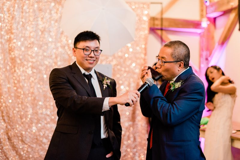 Father of the Groom plays harmonica for mother-son dance