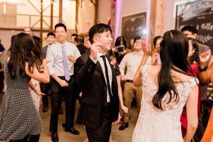 Groom dancing at reception