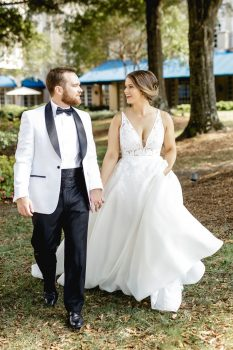 Groom in White tux jacket and black pants