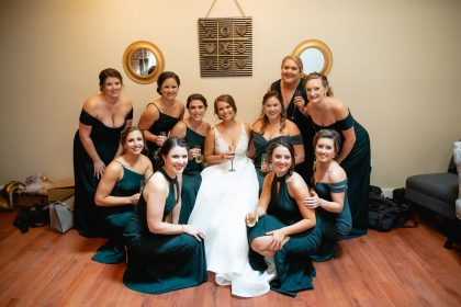 Bride and Bridesmaids pre-ceremony at The Cloth Mill in Emerald Green Dresses