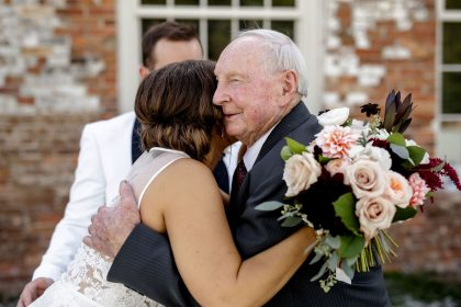 Bride hugging Grandfather of the Groom