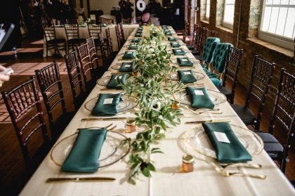 Long Table centerpieces with greenery runner