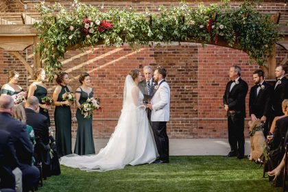 Wedding Vows under floral arch