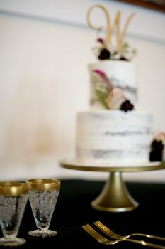 Pastry Works white naked cake with antique champagne glasses