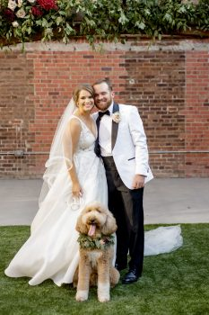 Bride and Groom with dog wearing floral collar
