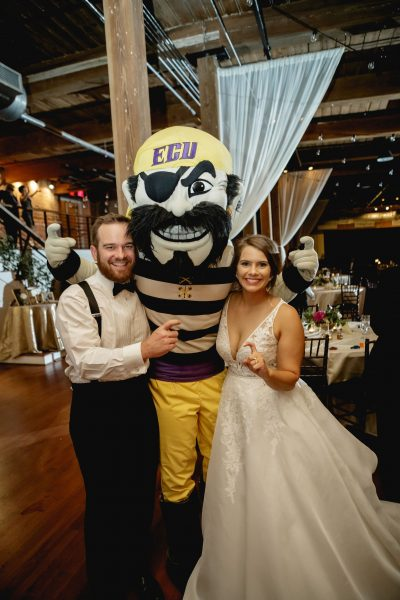 Newlyweds with Pee Dee Pirate at their reception