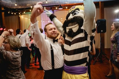 ECU's Mascot celebrating with groom