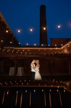Bride and Groom Twilight Photo Under Market Lights JCM Photography