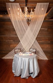 Sweetheart table with draping and chandelier