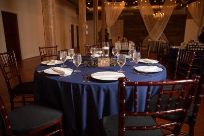 Round Table Setting with Navy linen and greenery
