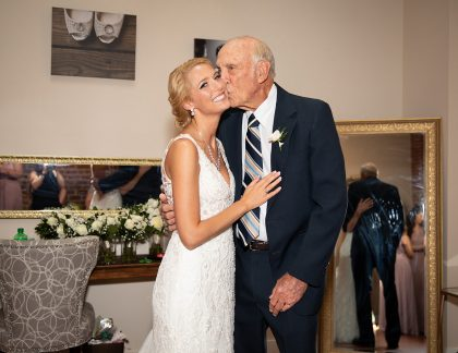 Bride and Grandfather before wedding ceremony
