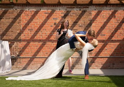Groom Dips Bride for First Kiss as newlyweds