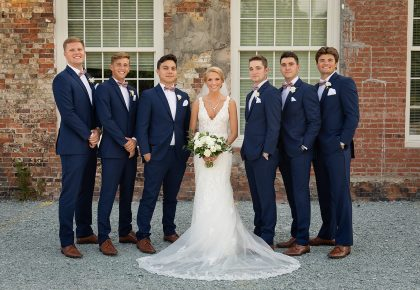 Bride with Groomsmen in Navy Suits