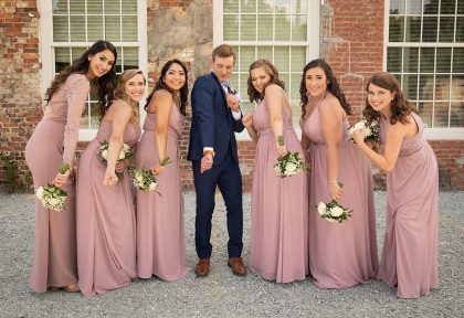 Groom with Bridesmaids in Mauve Dresses