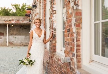 Bridal Portrait in front of Industrial Brick Wall