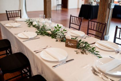 Long Table Setting with Greenery and white roses