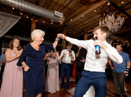 Groom and Grandma dancing at wedding reception