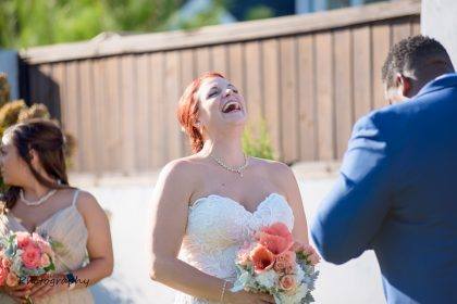 joyful smiling bride outdoor ceremony