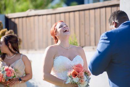 joyful smiling bride outdoor ceremony
