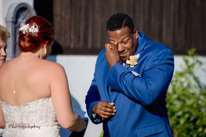 groom tearing up during wedding ceremony