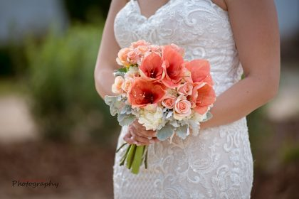 beaded wedding gown with peach, yellow and white bouquet with lambs ear