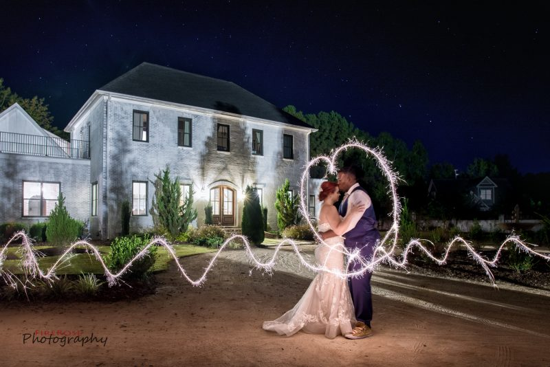 Cool sparkler photo bride and groom Fire Rose Photography