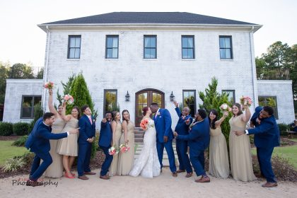 blue suits and sage bridesmaid dresses at The Bradford NC
