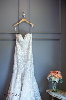 strapless wedding gown on hanger