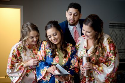 bridesmaids deliver bride's gift to groom