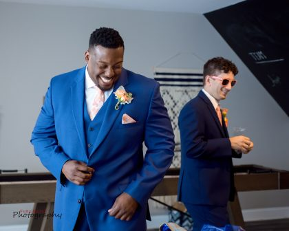 Groom and Groomsmen in blue suit with peach tie