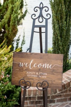 wood welcome sign with vinyl lettering on easel
