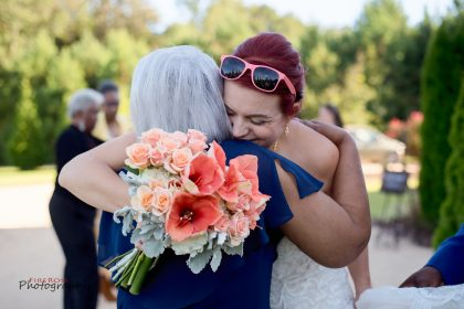 bride hugging mother-in-law