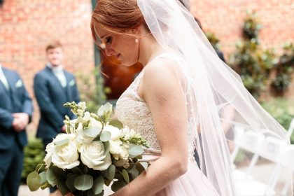 Redhead Bride with white flowers and blush wedding dress