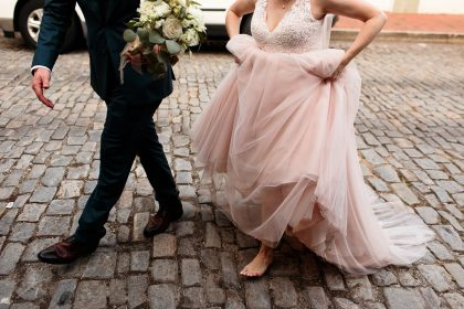 Blush Wedding Gown and white flowers navy suit