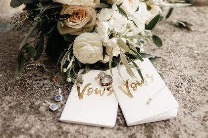Day-of Wedding Coordination Wedding Vow Books and White Florals