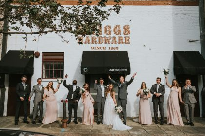 Wedding party with gray suits and peach bridal dresses